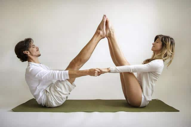 buddy boat pose couples yoga poses